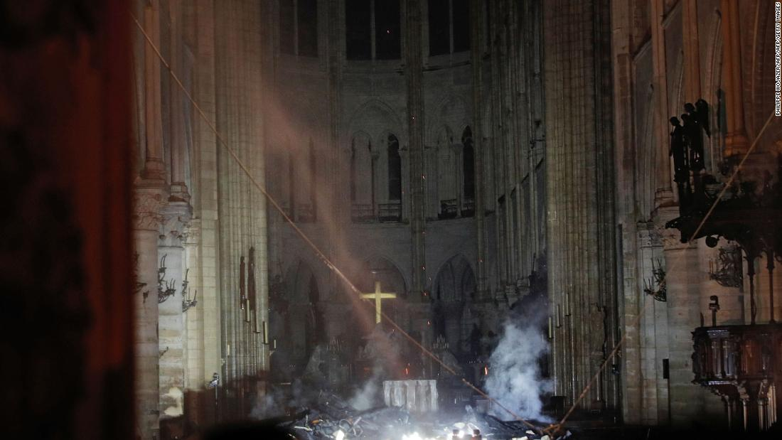 Notre Dame fire started at the center of the cathedral's roof, says police source