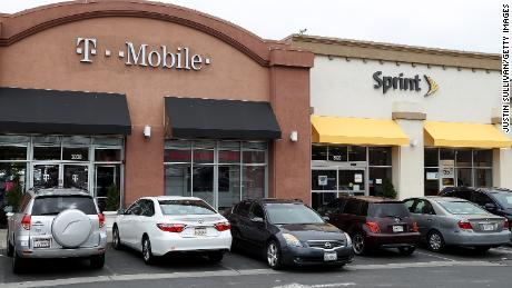 EL CERRITO, CA - APRIL 30:  A T-Mobile and Sprint store sit side-by-side in a strip mall on April 30, 2018 in El Cerrito, California. T-Mobile announced plans to acquire Sprint for $26 billion to merge the two telecom companies.  (Photo by Justin Sullivan/Getty Images)