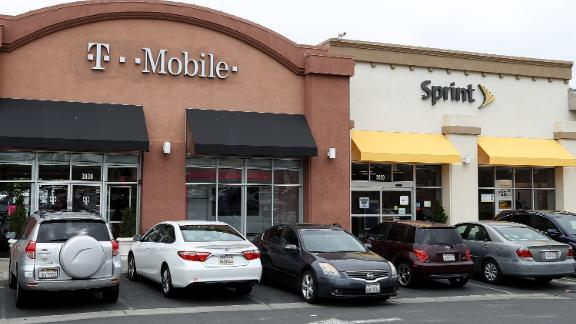 A T-Mobile and Sprint store sit side-by-side in a strip mall on April 30, 2018 in El Cerrito, California. T-Mobile announced plans to acquire Sprint for $26 billion to merge the two telecom companies.