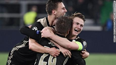 Joel Veltman, Lasse Schone and Matthijs de Ligt celebrate victory over Juventus.