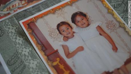 The two daughters of Adbia Hayrat, Ansila Esten and Nursila Esten, in a family photo of their father.