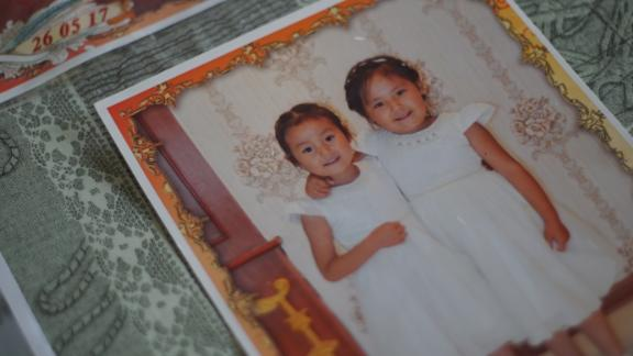 Adbia Hayrat's two daughters, Ansila Esten and Nursila Esten, in a family photo kept by their father.
