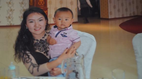 Adiba Hayrat and her son Nurmeken, who has been separated from his mother for more than a year.