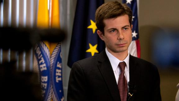 South Bend Mayor Pete Buttigieg listens to a question during a news conference announcing deputy coroner Chuck Hurley as the interim South Bend Police Department chief on Friday, March 30, 2012, in the mayor's downtown office in South Bend, Ind. Buttigieg said Darryl Boykins, former city police chief, resigned as federal investigators are looking into the wiretapping of police department phones.  (AP Photo/South Bend Tribune, James Brosher)