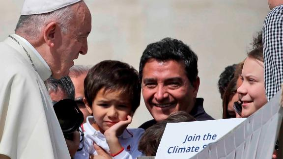 Pope Francis greets Swedish teenage environmental activist Greta Thunberg, right, during his weekly general audience in St. Peter's Square, at the Vatican, Wednesday, April 17, 2019. (AP Photo/Alessandra Tarantino)