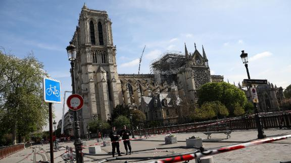 Police officers stand guard in front of Notre-Dame Cathedral following a major fire on Monday on April 17, 2019 in Paris, France.