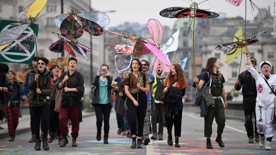 Activists carry model insects as the demonstrate on Waterloo Bridge on April 16.