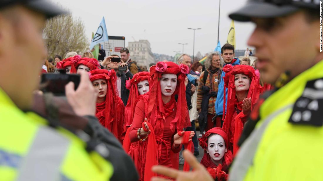 Members of the Extinction Rebellion group talk with police during a demonstration at Waterloo Bridge.