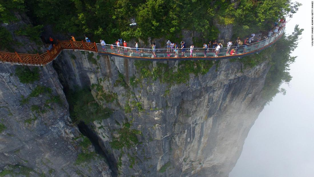 <strong>Zhangjiajie National Forest Park, China.</strong> Known for its towering sandstone pillars, this forest is best explored on foot. Visitors can experience spectacular views on the 100-meter-long and 1.6-meter-wide glass skywalk clinging to the cliff of Tianmen Mountain.
