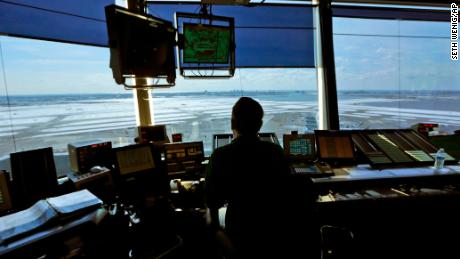 Air traffic controllers work in the tower at John F. Kennedy International Airport in New York, Thursday, March 16, 2017. (AP Photo/Seth Wenig)