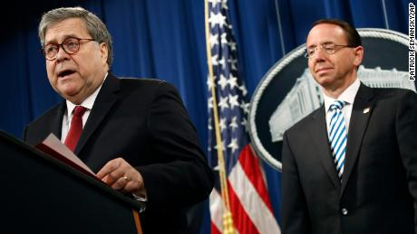 Attorney General William Barr speaks alongside Deputy Attorney General Rod Rosenstein, right, Thursday, April 18, 2019, at the Department of Justice in Washington. (AP Photo/Patrick Semansky)