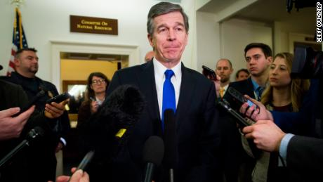North Carolina Gov. Roy Cooper speaks with reporters after testifying before the House Natural Resources Committee hearing on climate change in Washington on February 6.