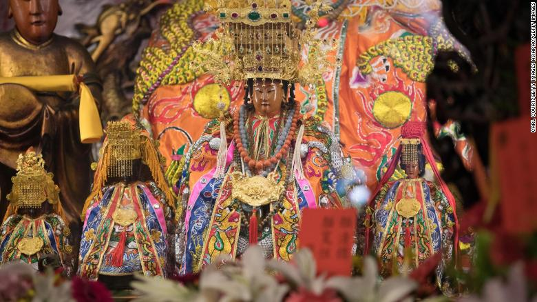 A statue of the goddess Mazu (front) is displayed in Jenn Lann Temple following its return after being carried in a sedan chair on the nine day Mazu pilgrimage on April 23, 2018 in Dajia near Taichung, Taiwan.