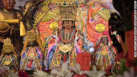 A The Statue of the Goddess Mazu (front) is on her return to the Jenn Lann Temple after being carried in a limousine during the nine-day Mazu pilgrimage on April 23, 2018 in Dajia, near Taichung, Taiwan.