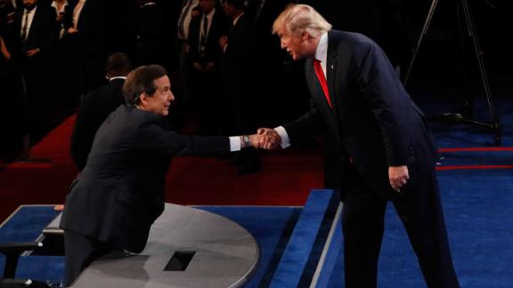 Donald Trump shakes hands with Fox News anchor and moderator Chris Wallace