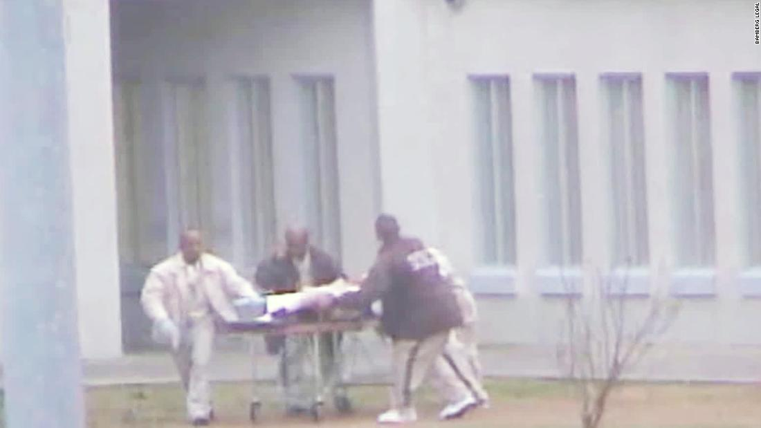An inmate who was stabbed was left to die in a prison yard by correctional officers, lawsuit says