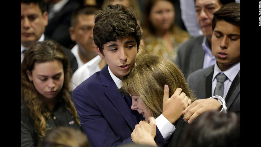 Federico Danton, son of Peru's former President Alan Garcia, consoles his mother, Roxanne Cheesman, during a wake for Garcia after he fatally shot himself on Wednesday, April 17, in Lima, Peru. At the time of his death, Garcia, who served as president from 1985 to 1990 and from 2006 to 2011, was under investigation for money laundering and taking bribes in connection with a massive corruption scandal that has engulfed a number of former Latin American leaders.