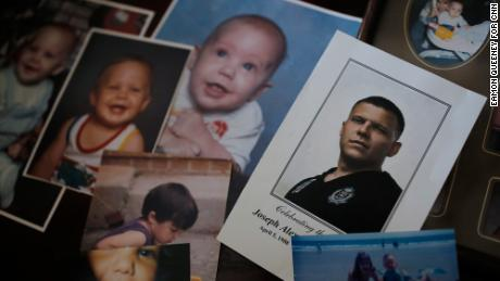 Jennifer Alba goes through old photos of her son Joseph at her home in Apex, North Carolina.
