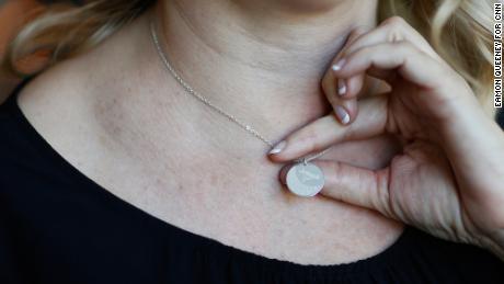 Jennifer Alba shows a necklace with son Joseph's fingerprint.