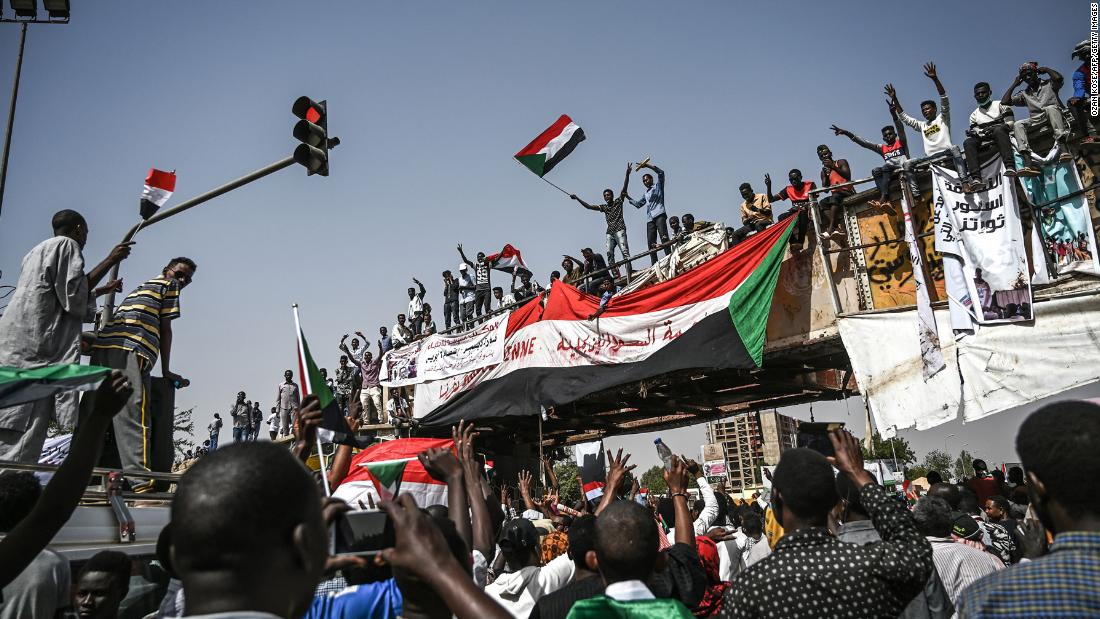 "Sudanese protesters rally outside the army complex in the capital Khartoum on Wednesday, April 17, after a military coup that ousted President Omar al-Bashir from power. Sudanese people have demanded the military leaders currently in power step down, though the military said it will remain in control for at least two years to oversee a ""transition of power."""