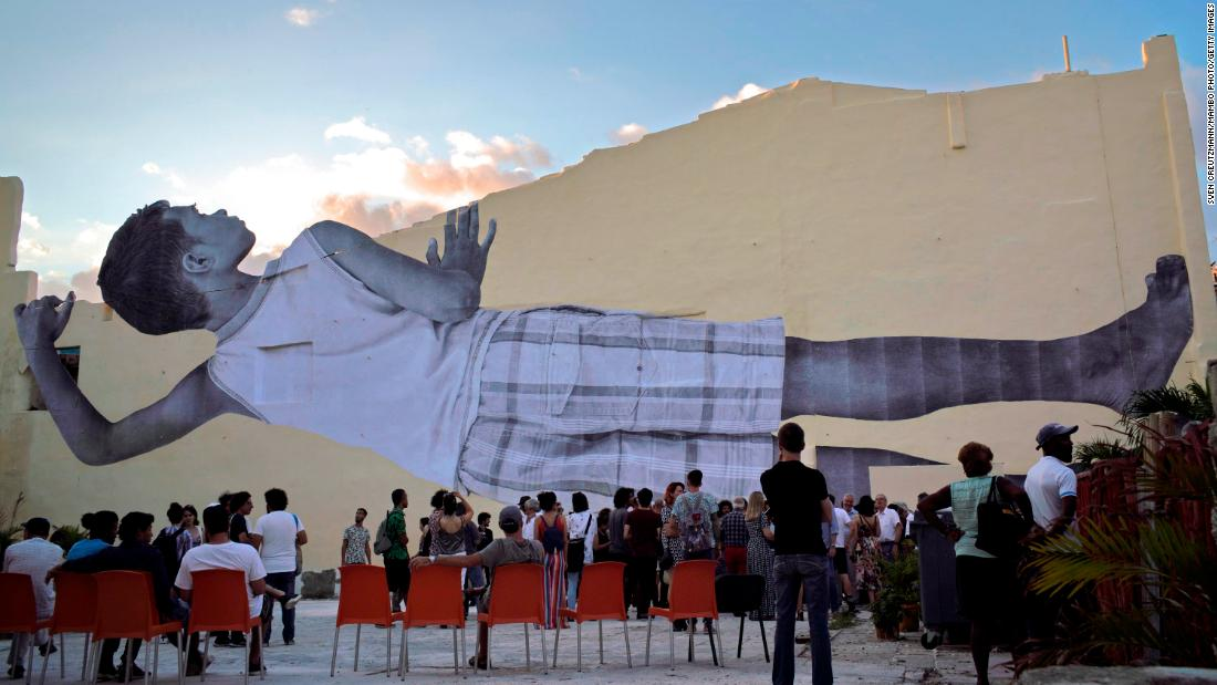 "An image by French artist JR called ""Giants"" is displayed during the 13th Havana Biennial on Saturday, April 13, in Havana, Cuba."