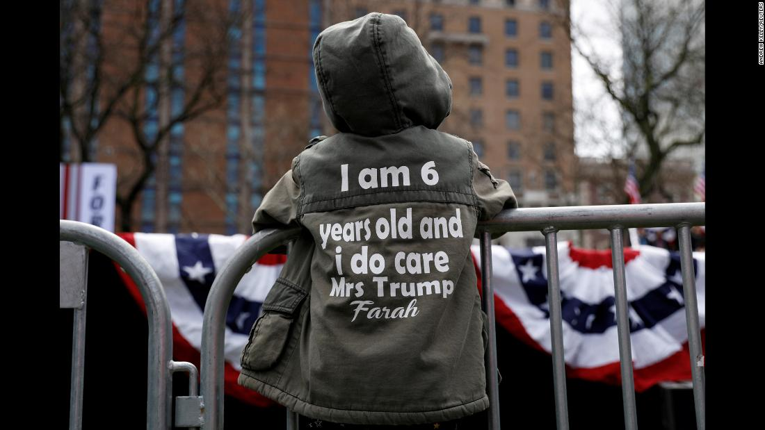 "Farah Asgarally waits by the stage ahead of US Sen. Cory Booker's Hometown Kickoff event on Saturday, April 13. Farah's jacket reads, ""I am 6 years old and I do care, Mrs. Trump."""