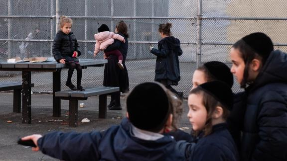 Children at a playground in Williamsburg, which has seen 294 confirmed cases of measles.