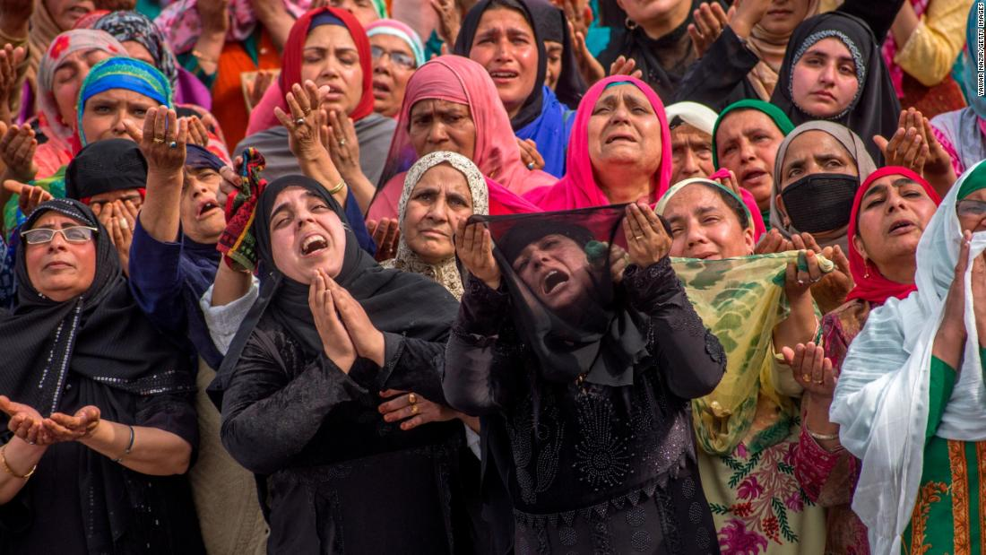 Kashmiri Muslim women pray as a relic believed to be a hair from the beard of the Prophet Mohammed is displayed at the Hazratbal Shrine on Friday, April 12, in Srinagar, India.