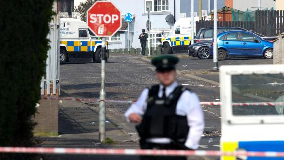 Police secure the area where a journalist was fatally shot amid rioting overnight in the Creggan area of Derry in Northern Ireland on April 19, 2019.