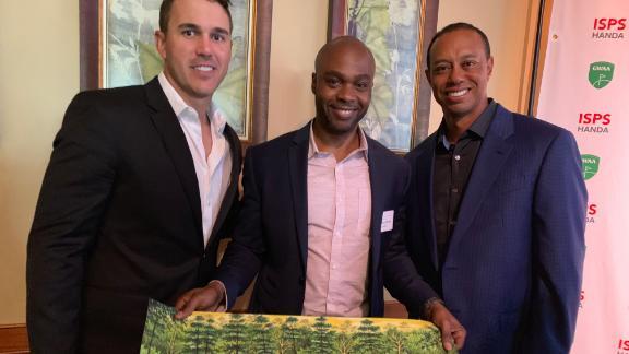 Valentino Dixon met Brooks Koepka (left) and Tiger Woods (right).