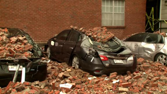 Storm rips brick facade off apartment building in Mississippi.