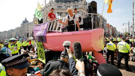 British actress Emma Thompson talks to the media from atop the pink climate change boat Friday.
