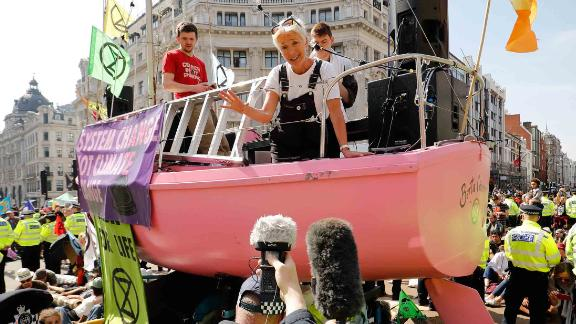 British actress Emma Thompson talks to members of the news media on Friday, April 19, from atop a boat being used by climate activists to blockade the Oxford Circus junction in central London.