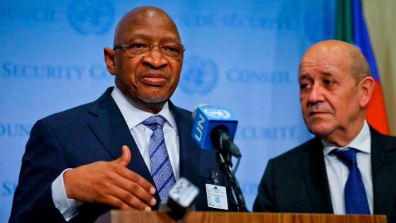 Prime Minister of Mali Soumeylou Boubèye Maïga, left, and France Foreign Minister Jean-Yves Le Drian, right, hold a press briefing meeting in the United Nations Security Council at U.N. headquarters, Friday March 29, 2019. (AP Photo/Bebeto Matthews)