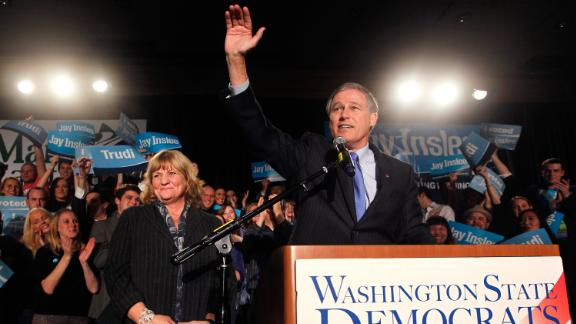 Inslee is joined by his wife, Trudi, during an election-night party in 2012. He defeated Republican Rob McKenna with 51.54% of the vote.