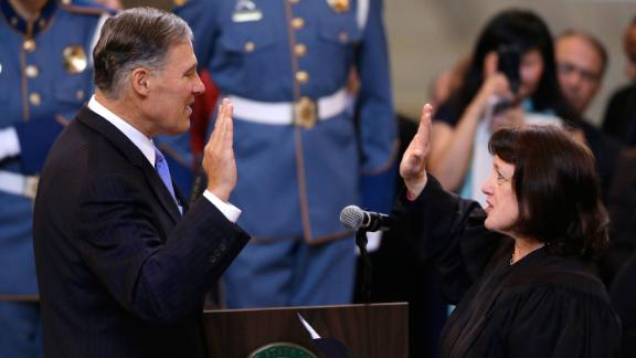 Inslee is sworn in as governor in January 2013.