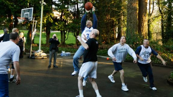 Inslee plays basketball at the governor