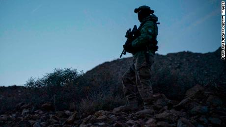 "Stinger, a member of Constitutional Patriots New Mexico Border Ops Team militia is pictured on patrol at the US-Mexico border near Mt. Christo Rey in Sunland Park, New Mexico on March 20, 2019. - The militia members say they will patrol the US-Mexico border near Mt. Christo Rey, ""Until the wall is built."" In recent months, thousands of Central Americans have arrived in Mexico in several caravans in the hope of finding a better life in the United States. US President Donald Trump has branded such migrants a threat to national security, demanding billions of dollars from Congress to build a wall on the southern US border. (Photo by Paul Ratje / AFP)        (Photo credit should read PAUL RATJE/AFP/Getty Images)"