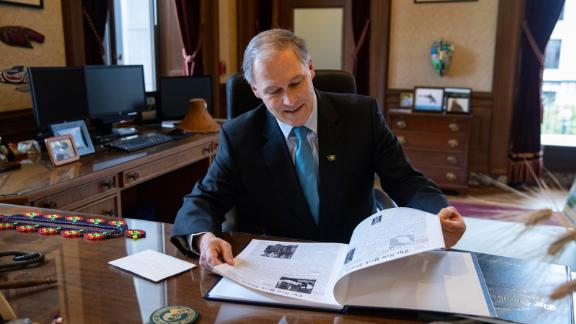Inslee sits in his office in Olympia, Washington, in February 2019.
