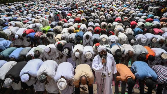 Demonstrators attend Friday prayers outside the army headquarters on April 19.