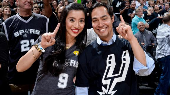 Erica and Julian Castro watch the San Antonio Spurs play in the NBA Finals in 2013.