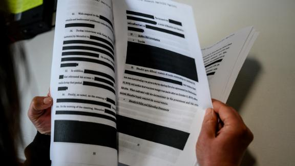 A journalist reads a redacted court filing from the Special Council Robert Mueller in the Paul Manafort case on April 16, 2019. - The final report from Special Counsel Robert Mueller's Russia investigation on April 18, 2019, could leave much of the public unsatisfied because it could be heavily redacted, stripped of significant evidence and testimony that the investigators gathered. Attorney General Bill Barr made clear he will edit out large parts of Mueller's 400-page final report on his investigation of President Donald Trump and Russian election meddling. (Photo by Eric BARADAT / AFP)        (Photo credit should read ERIC BARADAT/AFP/Getty Images)