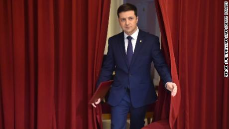 "Ukrainian comic actor and the presidential candidate Volodymyr Zelensky enters a hall in Kiev on March 6, 2019, to take part in the shooting of the television series ""Servant of the People"" where he plays the role of the President of Ukraine. - Anger with the political elite is partly behind the rise of Volodymyr Zelensky, a TV actor with no political experience who is the frontrunner in the upcoming presidential vote.  Zelensky is polling at 25 percent, ahead of Poroshenko on 17 percent and former prime minister Yulia Tymoshenko on 16 percent as of March 4, 2019. (Photo by Sergei SUPINSKY / AFP)        (Photo credit should read SERGEI SUPINSKY/AFP/Getty Images)"