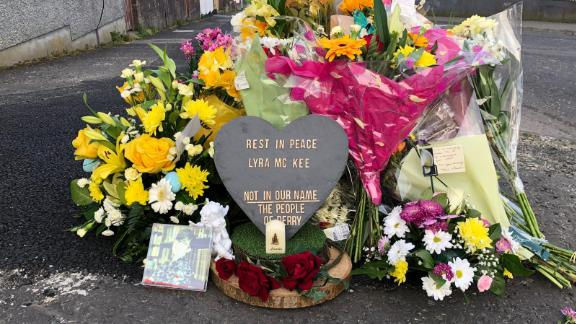 Flowers and tributes are left near the spot where Lyra McKee was shot on Thursday night.