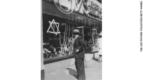 "Before they had to give up their businesses, Jewish merchants in the Nazi era had to mark their stores with a Star of David and word Juden, which means ""Jews."""