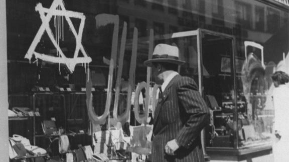 """Before they had to give up their businesses, Jewish merchants in the Nazi era had to mark their stores with a Star of David and word Juden, which means """"Jews."""""""