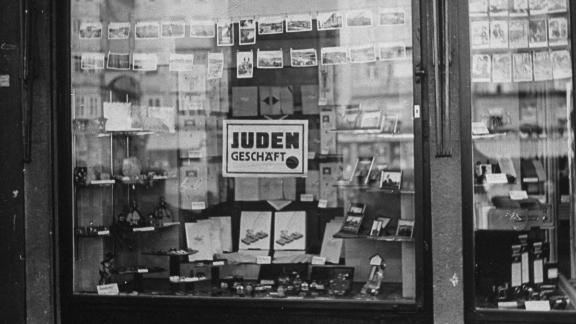 Nazi law required Jewish merchants to post signs saying their businesses were Jewish-owned.