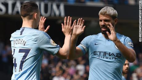 Phil Foden celebrates his winning goal with Sergio Aguero.