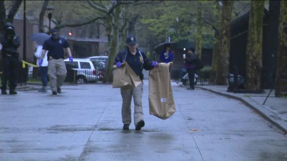Crime technicians carried bags of presumed evidence to police vehicles.