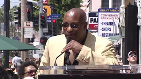 John Singleton speaks during the dedication ceremony for his star on the Hollywood Walk of Fame on August 26, 2003.
